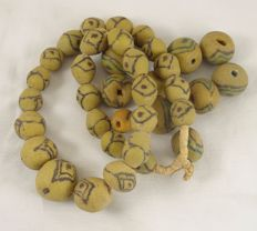 1 necklace and 10 loose old Yellow Krobo Powderglass beads