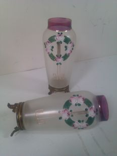 A set of glass vases with floral enamelled decor in copper case