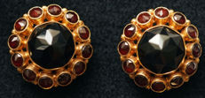 Yellow gold earrings set with 1 large central garnet and 12 smaller garnets