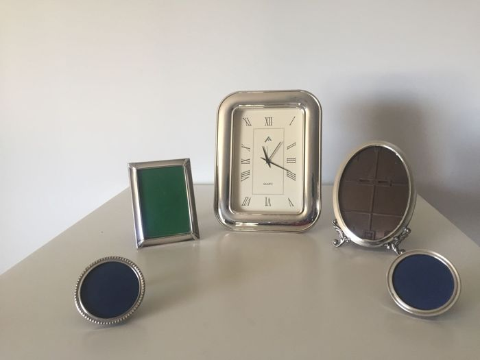 Four different silver photo frames and a silver clock - Spain - second half 20th century