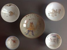 Five different size Imperial Japanese army cavalry sake memorial cups - images of horses, cherry blossom, the Japanese rising sun flag, a crane and the Japanese military star