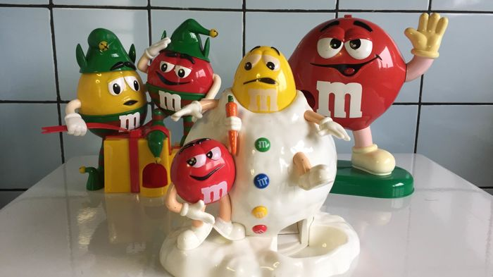 Three M&M dispensers
