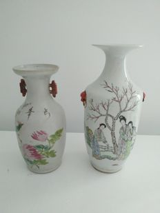 2 porcelain baluster vases of the Famille rose with decoration of women, flowers, and birds – China – Republic period (1912-1949).