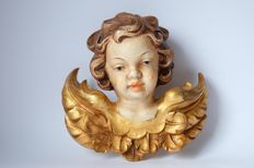 Wooden carving of a cherub's/angel's head from South Tyrol