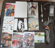 Wii + nunck + 2 controllers + 8 topgames wii sport + wii play + megamind en more