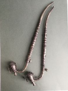 2 richly decorated opium pipes with a butterfly of silver plated metal - ca. 1950, Thailand