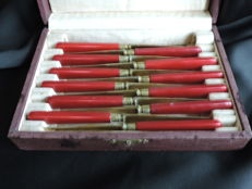 Antique 12 piece knife set-particularly in terms of colour and design