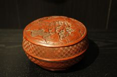 Round lidded box in sculpted red lacquer - China - circa 1900