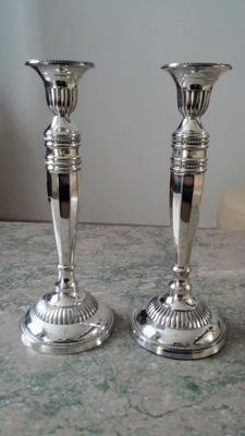 2 Antique heavily silver plated candle stands.