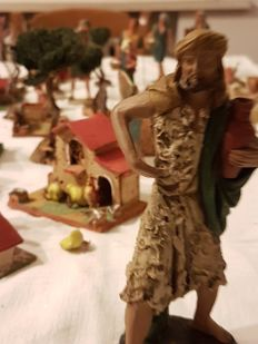 Unique and wonderful lot of 68 handmade characters and houses for Christmas creche - made of terracotta, resin, cork and wood