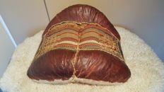 Antique camel saddle; leather with kilim cloth (upholstery) in the middle