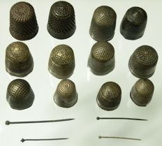 Collection of 17th century brass thimbles and pins 20 mm to 40 mm (12)