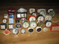 A collection of 32 vintage alarm clocks
