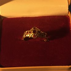 Yellow gold ring with 9 rubies of 0.25 ct - Weight: 2.12 g. *Period 1960/70*
