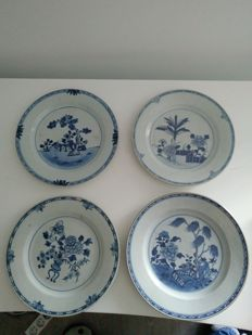 4 white blue porcelain dishes with flower decoration – China – 18th century