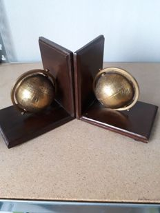 Bookends decorated with copper globes.