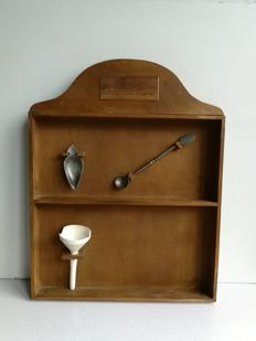Pharmacists wall cabinet for medical collectibles (pharmacists cabinet), including: Porcelain funnel, pewter medicine spoon and pewter spoon.