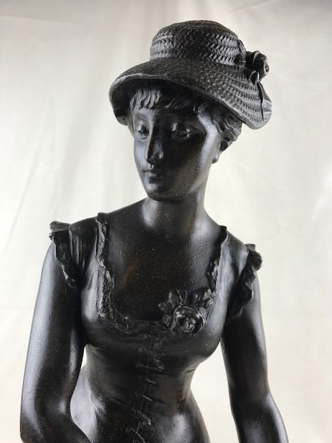 Very beautiful patinated zamak sculpture - young lady with half closed eyes - France - circa 1900