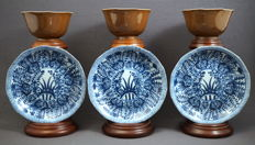 Collection of identical cups and saucers with capuchin relief glaze, Kangxi marked - China - 19th century