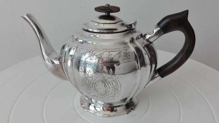 """Royal Sheffield Family"" English silver teapot"