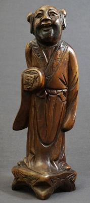 Wooden sculpture depicting a standing man in a long robe - China - 19th century