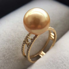 Natural seawater, golden pearl, 18K gold Ring. Pearl diameter: 10 mm. Weight: 3.5 G. A new-size 6.75 US-Free resizing