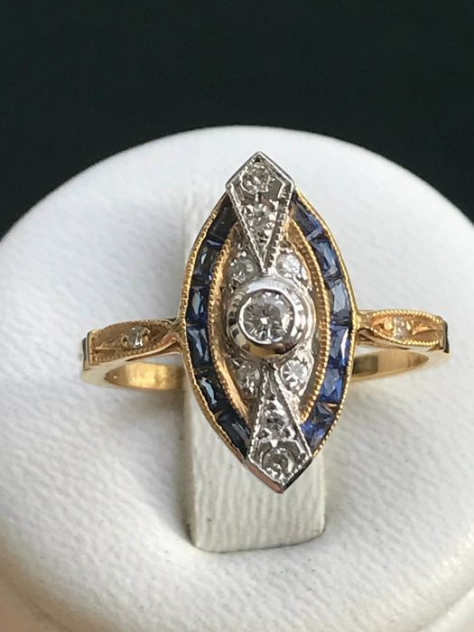 Marquise ring in 18 kt gold set with diamonds and sapphires, totalling 1.05 ct, size: 53 / 16.77 mm