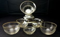 Baccarat, set of 7 pieces in cut and chiselled crystal with gold finishings