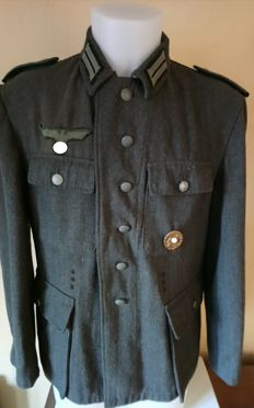Tunic of German soldier, first class/troop of the Feldzug, model 1936, modified in 1943