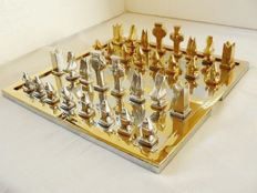 Chess designed by David Marshall Aluminium and brass.