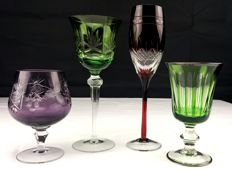 Baccarat, Saint Louis. Lot of 4 pieces in cut, chiselled crystal