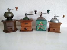 Four old classic coffee grinders