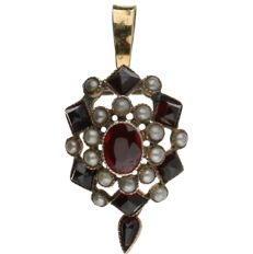 14 kt Yellow gold pendant set with seed pearls and glass garnet.