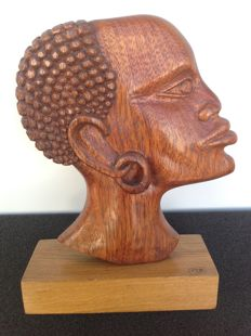 Solid wooden sculpture of an African tribal chief - signed