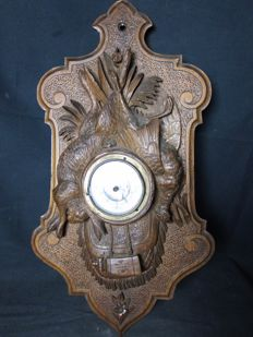 Black Forest barometer of carved walnut - in the form of a hunting trophy with hare and pheasant - ca. 1900