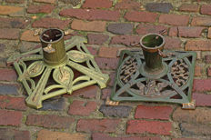 Two iron Christmas tree stands