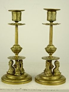 A pair of bronze candlesticks with dolphins - France - 19th century
