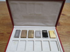 6 ST DUPONT lighters in a leather Dupont display box from the 40-80s