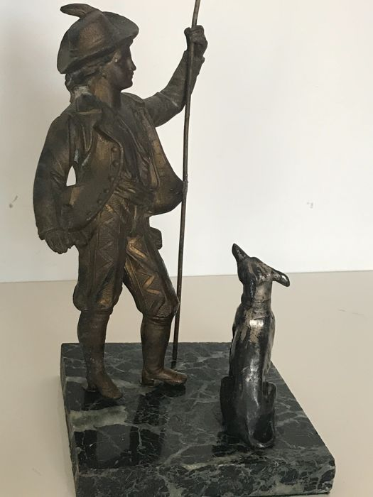 Statue Of A Shepherd Boy And His Dog Stock Photo - Image