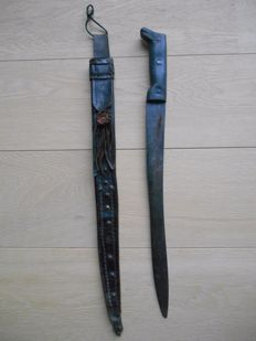 antique Mexican machete in leather sheath