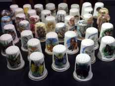 Collection of 41 porcelain thimbles with cabinet
