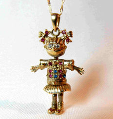 Necklace and pendant in solid gold in the shape of an articulated rag doll