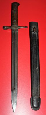 Bayonet for 6.5 mm Carcano M 1891, Italy, in good condition,  Clear numbers Maker: Terni. Leather sheath with metal parts
