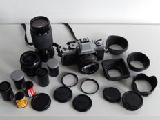 Minolta XG-M set complete, with 2 lenses, leather bag and accessories