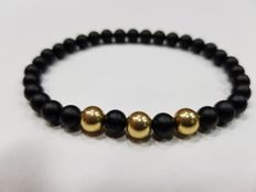 Bracelet in 18 kt gold with natural onyx