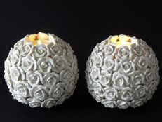 Two large white round candle holders with roses