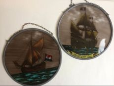 Two pieces of stained glass SunCatchers depicting ships