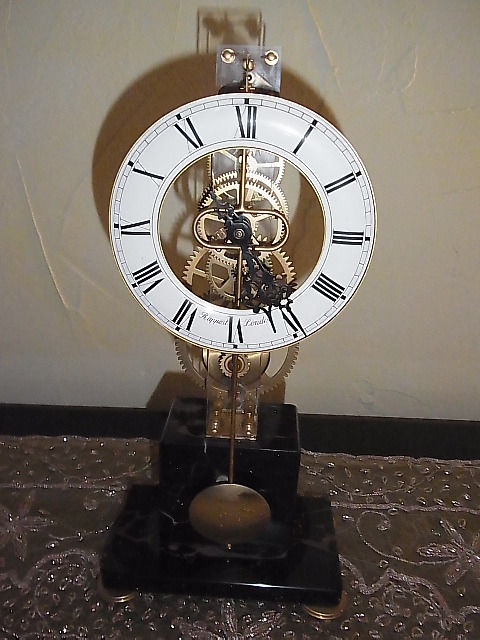 Small table clock skeletonised - signed with Rapport - London