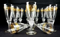 Set of 12 pieces in cut and chiselled crystal, with 24 kt gold decorations