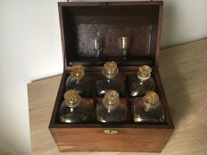 Mahogany liqueur cellar with 6 decanters and 2 glasses - The Netherlands - 19th century
